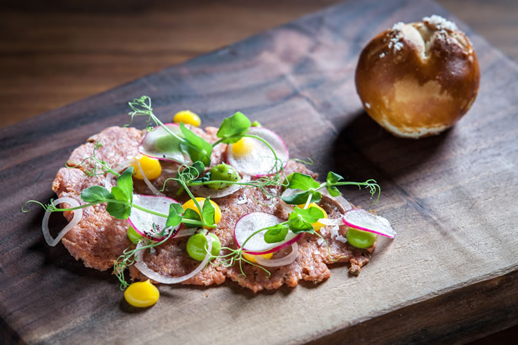 Beef tartare at Hospoda pairs well with Pilsner Urquell.