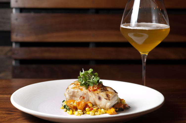 Sea bass is paired with Brewery Ommegang's Duvel Rustica at The Abbot's Cellar in San Francisco. (Courtesy of Katherine Sacks/starchefs.com)