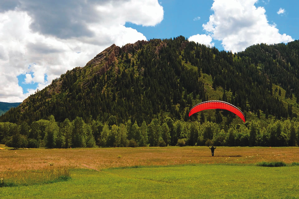 Feel the sensation of flying with Aspen Paragliding flights, which take off at 11,000 feet and sometimes soar to 12,000 feet or higher. (Courtesy of Brett Friel)