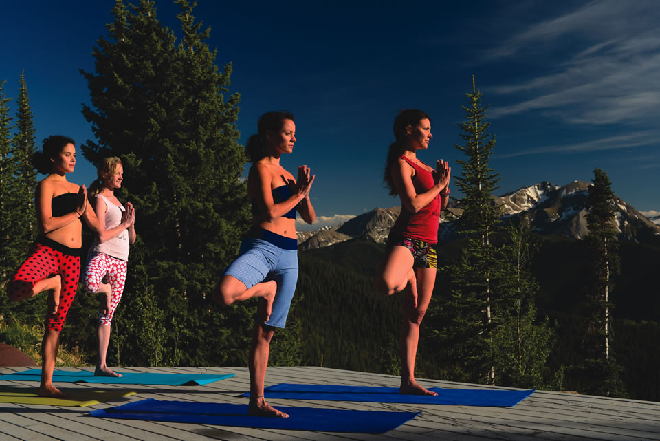 After hiking up Aspen Mountain, partake in a yoga session surrounded by nature. (Courtesy of Aspen Skiing Co.)