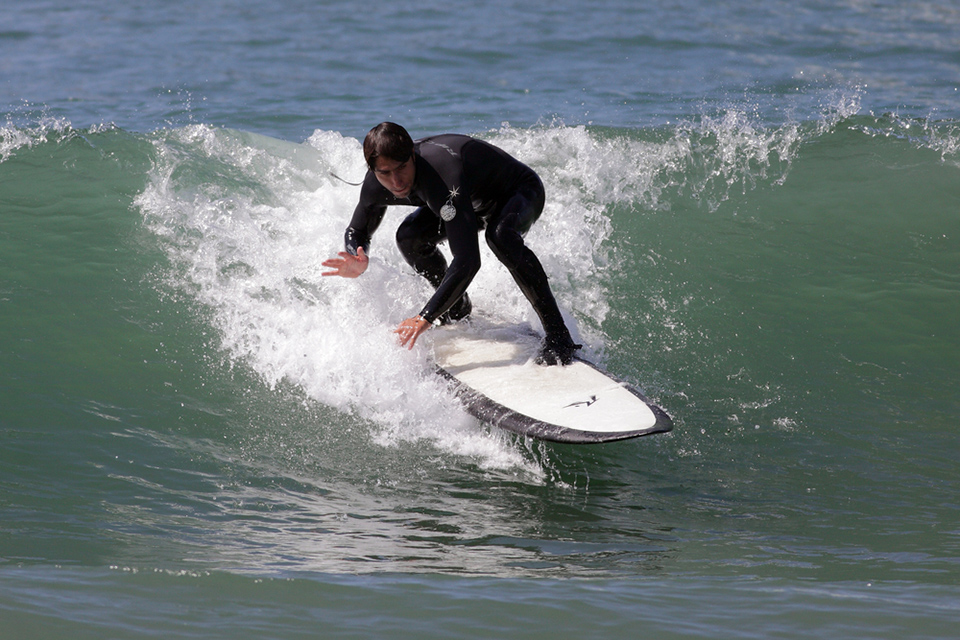 A surfer catches a big wave at Manhattan Beach, one of four South Bay beaches presenting the International Surf Festival this summer. (Courtesy Digital Media Pro/Shutterstock.com)