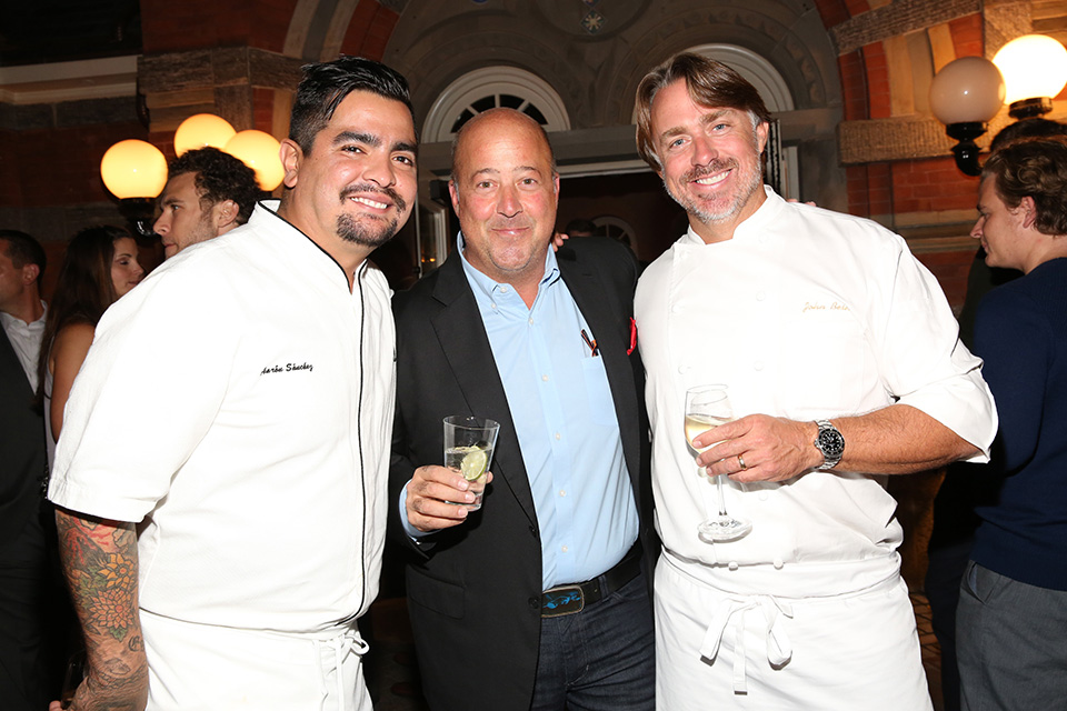 Top Dog will be hosted by chef Andrew Zimmern (middle), pictured here with chefs Aarón Sánchez (left) and John Besh. (Photo by Mireya Acierto/Getty Images for NYCWFF)